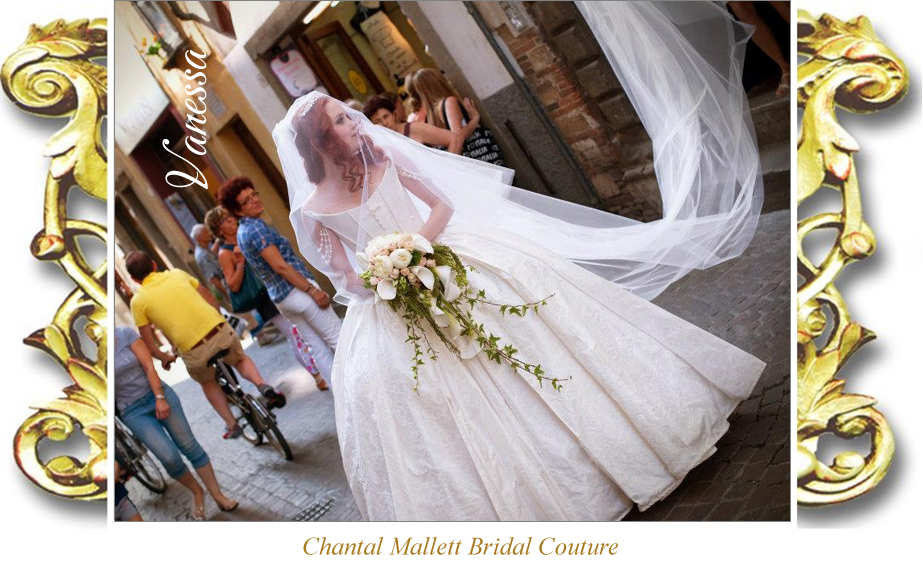 Couture, corseted wedding gownwith balgown skirt & train in ivory silk brocade by Chantal Mallett