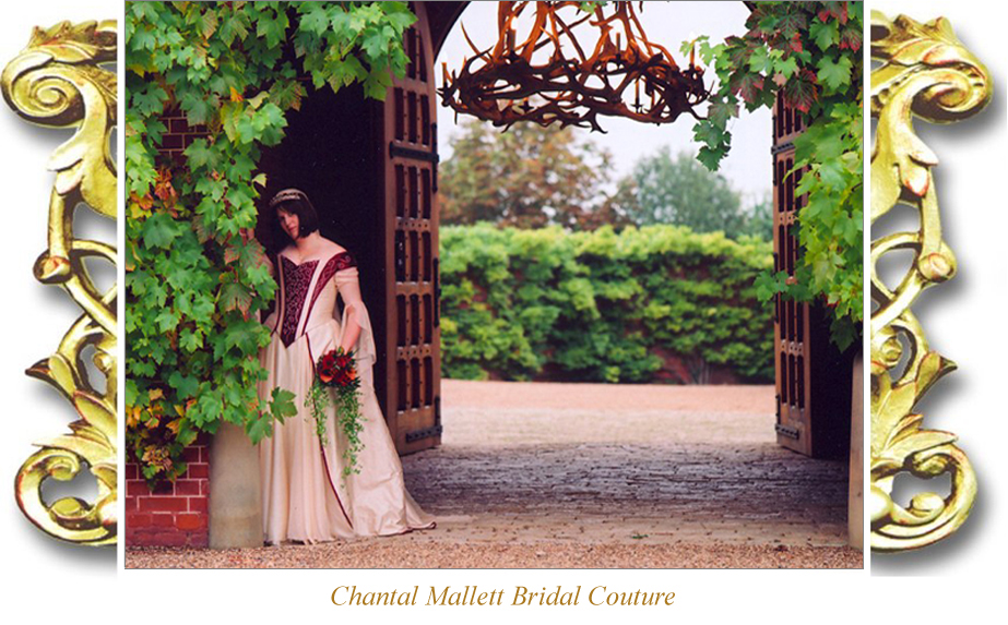 Bespoke cream & ruset silk corseted wedding gown with a-line skirt & trimmed with embroidery by Chantal Mallett