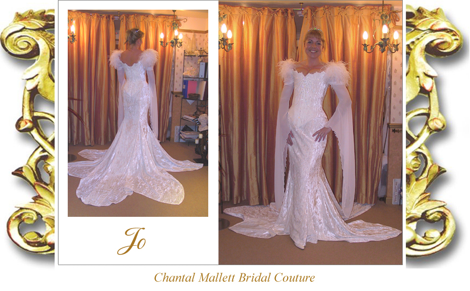 Couture, corseted wedding gown with mermaid skirt, feathers & georgette medieval sleeves in ivory velvet by Chantal Mallett.